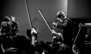 Conductor in front of orchestra