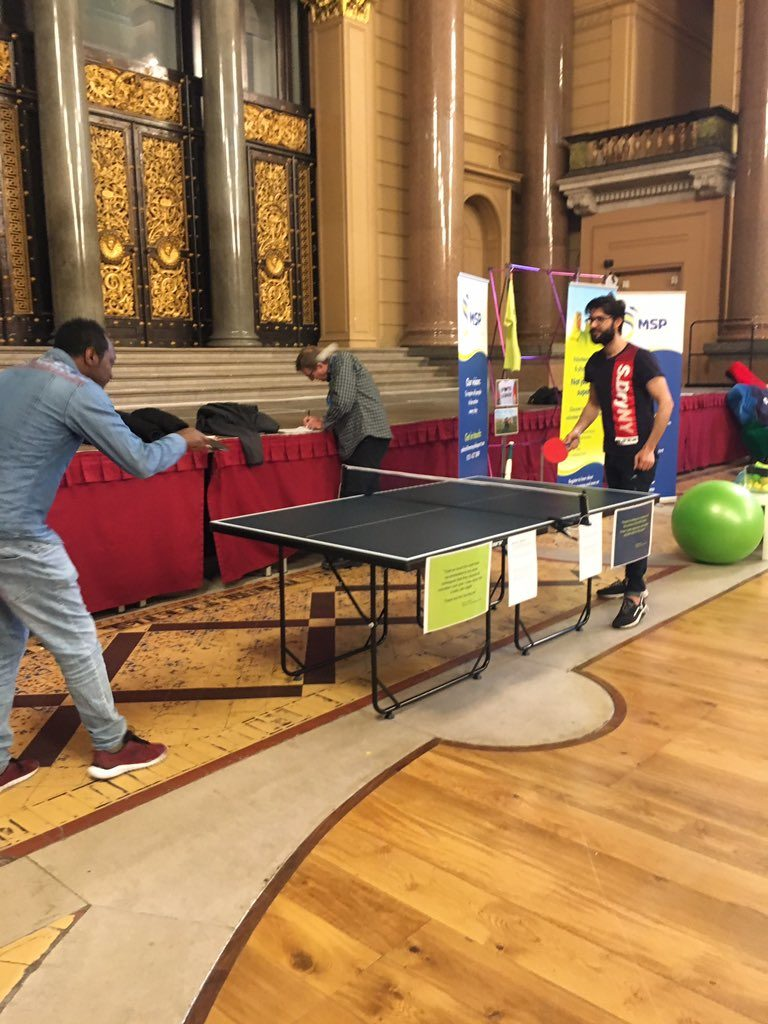 Image of volunteers playing table tennis at Liverpool Volunteer Show
