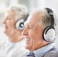 Senior man and woman wearing headphones
